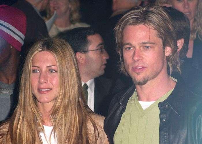 Brad Pitt with medium long dark blond hair in 90s